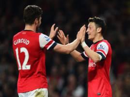 I giocatori dell'Arsenal esultano dopo aver segnato (Getty Images)