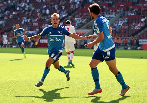 COLOGNE, GERMANY - AUGUST 29: Lewis Holtby (L) of Hamburg celebrates after he scores the opening goal during the Bundesliga match between 1. FC Koeln and Hamburger SV at RheinEnergieStadion on August 29, 2015 in Cologne, Germany. (Photo by Lars Baron/Bongarts/Getty Images)