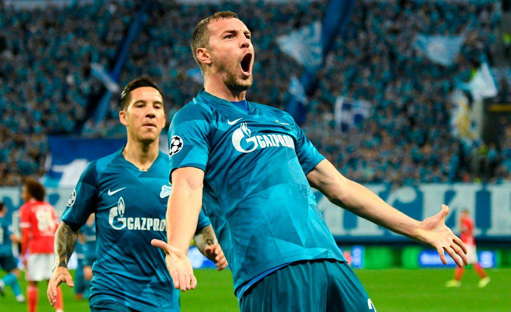 Zenit St. Petersburg's Russian forward Artem Dzyuba (R) celebrates with Zenit St. Petersburg's Argentine forward Sebastian Driussi after scoring a goal during the UEFA Champions League Group G football match between FC Zenit and Benfica at the Krestovsky stadium in Saint Petersburg on October 2, 2019. (Photo by Dimitar DILKOFF / AFP) (Photo by DIMITAR DILKOFF/AFP via Getty Images)